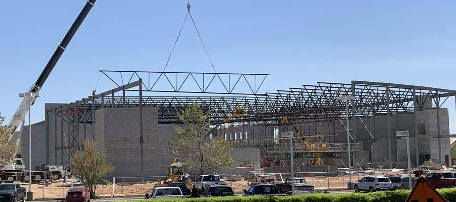 Rogers High School construction crane lower joist into position